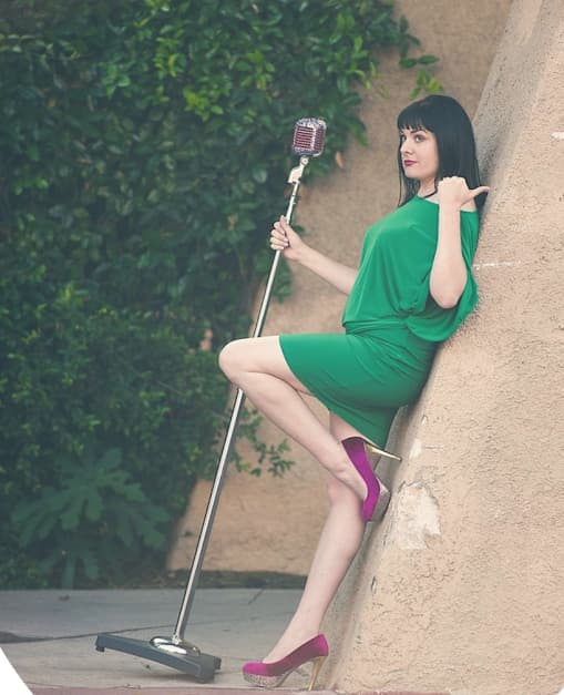 Molly Mahoney, who puts on the camera confidence course, leaning on a wall